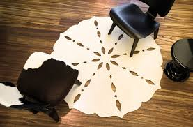 Shaped Area Rugs Cutting Rugs Creatively Shaped Area Carpet Designs