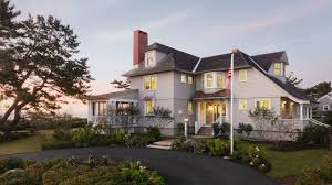 this shingle style cottage in a small coastal village provides its