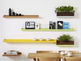 living room colored wall shelves white color wall wood shelves