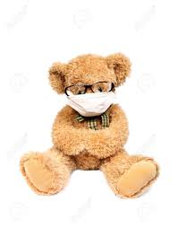 Contagious by Virus Risk Contagious Danger Teddy Bear With Mask Stock Photo