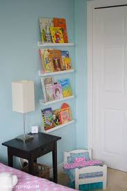 Ikea Ribba Picture Ledges To A Book Shelf Display With A Wall Of Books