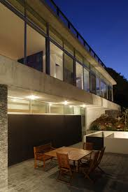 house with impeccable design mexico keribrownhomes architecture outdoor dining room with wooden table chair plus bench seat and cement