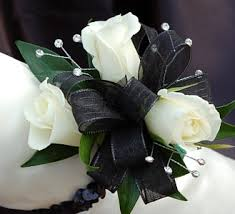 and black corsage white sweetheart corsage black