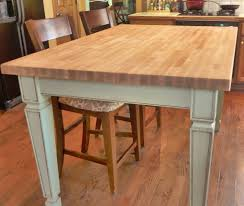hand made butcher block kitchen table by custom woodworks