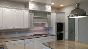 refinish kitchen cabinets paint or stain cabinet painting and refinishing flying colors painting co