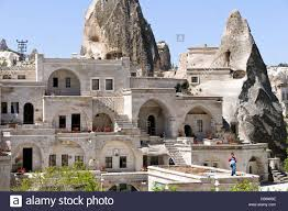 goreme town cappadocia turkey hotel and rock formations stock