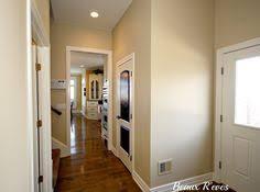sherwin williams creamy in a dark hallway with benjamin moore gray