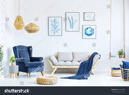 white blue living room sofa armchair stock photo 637114588 white and blue living room with sofa armchair lamp posters