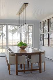 A Ceiling Canopy Creates A Sleek Finish For This Dining Room - Pendant lighting for dining room
