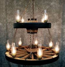 Mason Jar Wagon Wheel Chandelier Wagon Wheel Lighting Find This Pin And More On House Ideas Wagon