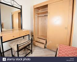 interior design dressing table with mirror and wardrobe in a