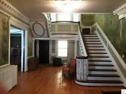 traditional staircase with crown molding hardwood floors in