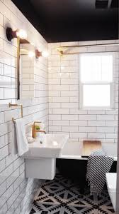 built in shower nook with white subway tiles and dark gray grout