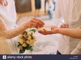 wedding registration happy taking white pillow witn rings during wedding stock