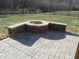 paver patio with stone firepit in charlotte by archadeck of