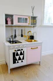 85 best playhouse inspiration images on pinterest play kitchens mommo design ikea hacks for girls a girly makeover for duktig play kitchen the gold accents the pink and black on white triangels