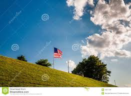 Baltimore Flag Clouds Over An American Flag On Federal Hill Stock Image Image