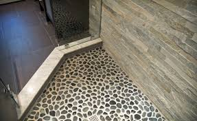 rock looking floor tile our shower floor is covered in smooth