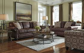 Leather Sofas And Chairs Faux Leather Sofa With Rolled Arms And Nailhead Trim By Benchcraft