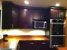 dark brown kitchen cabinets tribecca door style kitchen