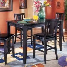 Carlyle Butterfly Leaf Table By Ashley Furniture AHFA Pub - Ashley furniture dining table black