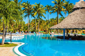 Beautiful Outdoors by Beautiful Outdoors Pool Surrounded By Palms In Varadero Stock
