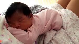 newborn on chest