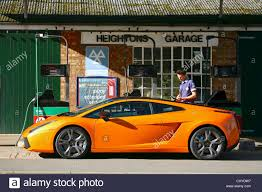 Lamborghini Gallardo Old - lamborghini gallardo at traditional petrol station stock photo
