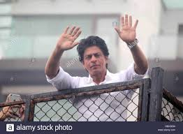 bollywood actor shahrukh khan waves towards his fans on occasion