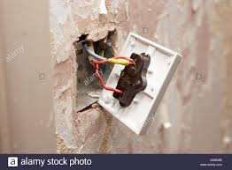 bare wiring on back of light switch in house being redecorated in