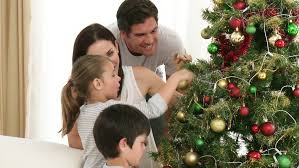 footage in high definition of family decorating a tree