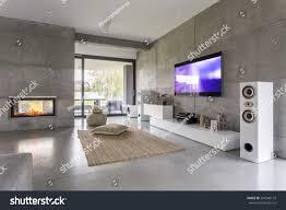 tv living room window fireplace concrete stock photo 554246170