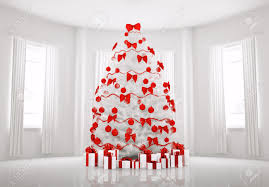 christmas tree with red decorations in the white room interior