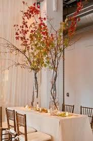 Tree Branch Centerpiece by Photo Via Manzanita Receptions And Wedding