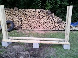 Diy Patio Furniture Cinder Blocks No Tool Firewood Rack Just Some Cinder Blocks 2x4s And Fence