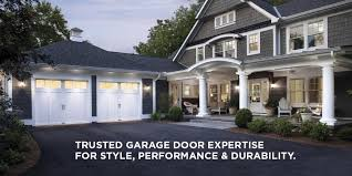 garage flooring storage organization garage living large gray home with a two car garage and white garage doors