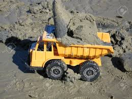 toy yellow truck dump load sand beach wet work working busy loaded