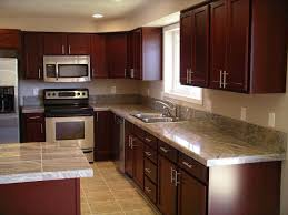 painting wood kitchen cabinets ideas top 75 lovely cherry wood kitchen cabinets with black granite knotty