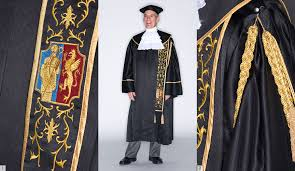 academic robes breaking the cap and gown