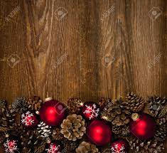 rustic wood background with ornaments and pine cones