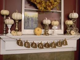 I like this banner idea for the kitchen fireplace brick wall Fall decor with pumpkins candlesticks mantle and banner