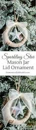 this sparkling star mason jar lid ornament is an inexpensive yet beautiful way to add new christmas ornaments to your christmas tree png