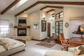 living large in small spaces hgtv com s ultimate house hunt hgtv master bedroom with ceiling beams and corner fireplace