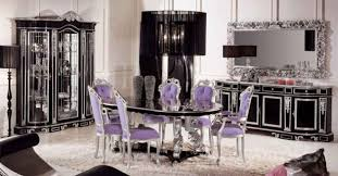 classical dining room with purple chairs and black furniture for