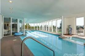 10 houses with swimming pools for sale in canada photos