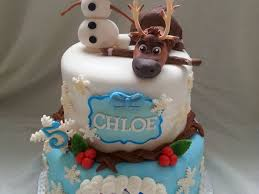 frozen themed birthday cake with handmade olaf and sven