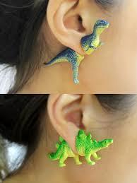 dinosaur earrings looking dino mite dinosaur half earrings geekologie