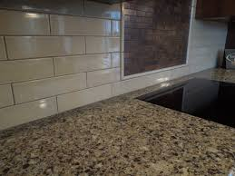 kitchen style white subway tile and metallic copper backsplash