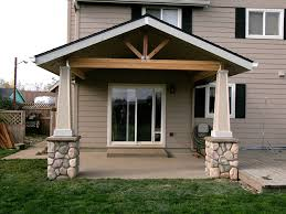 open gable patio cover with stone post bases tangent tnt builders