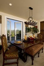 hurricane candle holders in dining room mediterranean with rustic